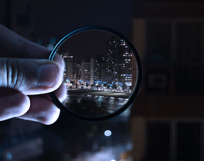 Audit process magnifying glass city